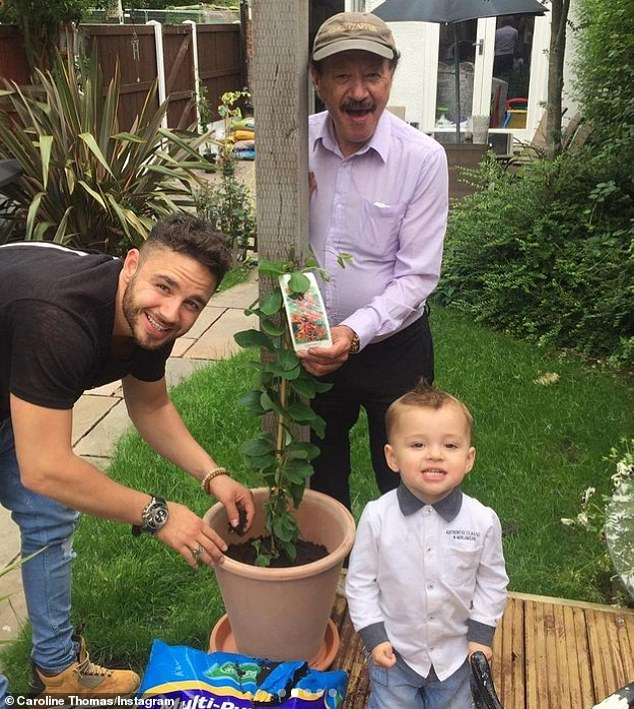 Getting stuck in: Dougie is pictured gardening with son Adam and grandson Teddy in another snap