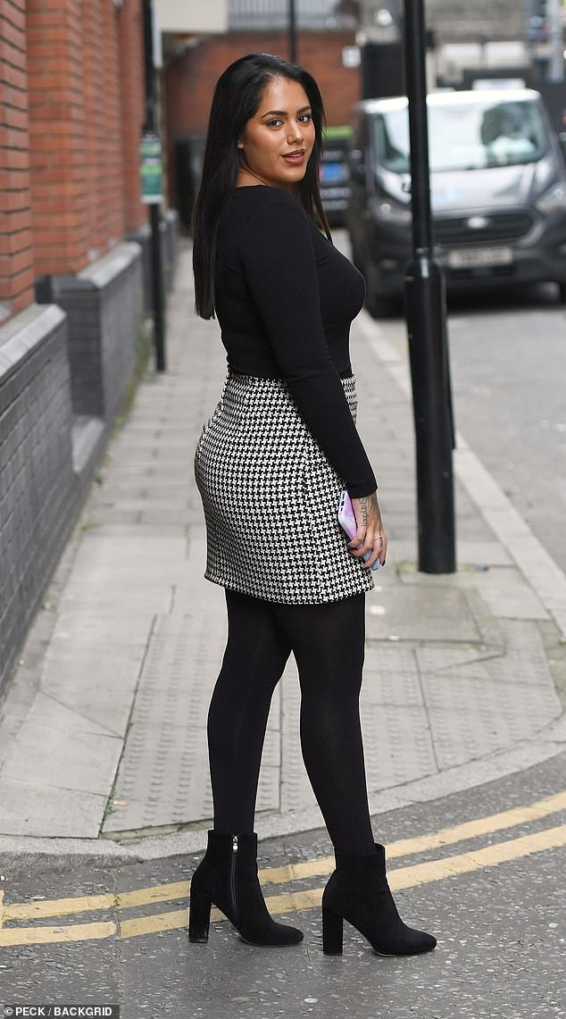 Body confident:The former Love Island star, 28, wowed in a black and white checked mini skirt and black jumper as she made her way down the street