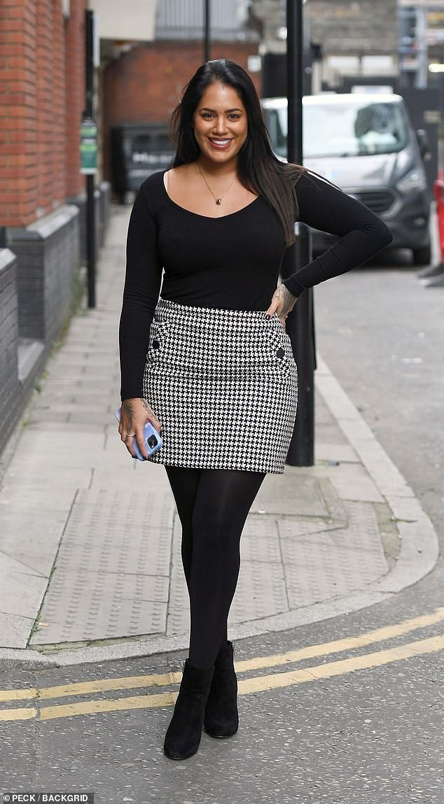 Winter style:Malin teamed her skirt and top with a pair of black tights and black ankle boots