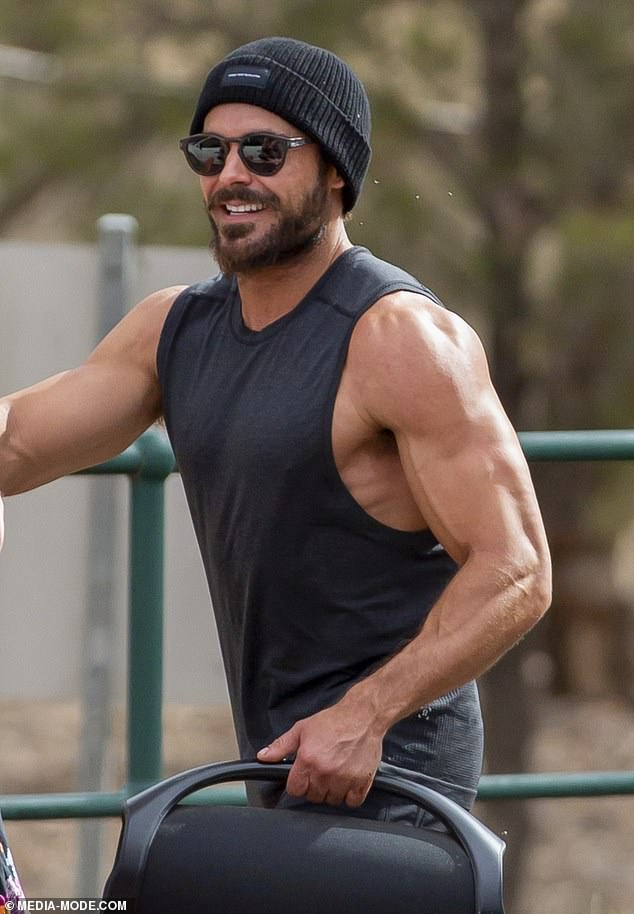 Magnificent:Zac showed just why he's become such a Hollywood heartthrob in recent years - as flaunted his impossibly muscular physique in a skimpy black tank top