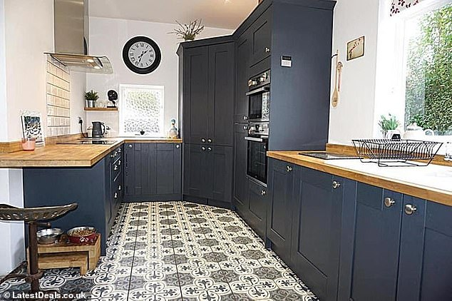 After: A couple who flip houses in their spare time have shared their renovation tips, including choosing bold colours over plain magnolia walls. Pictured, a kitchen renovated by the couple