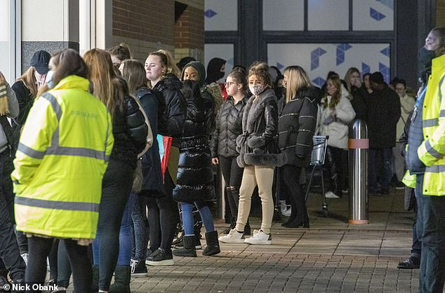 Above, shoppers line up outside the Primark store in Lakeside, West Thurrock.  Some said they stood in line until two o'clock