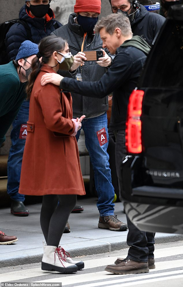 Sweet embrace: Upon meeting up with each other on set, Renner and Steinfeld exchanged a friendly hug and chatted away as excited onlookers snapped their picture