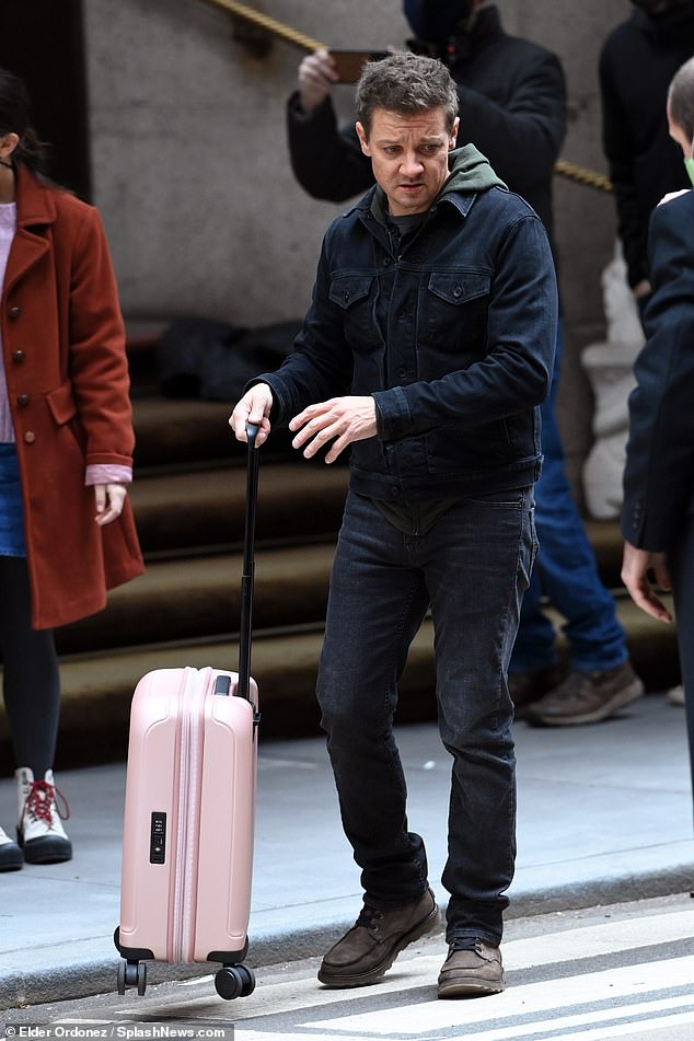 At ease: Renner unloaded multiple suitcases from a car and appeared in his element, after years of starring as Hawkeye multiple times in the Marvel Cinematic Universe films
