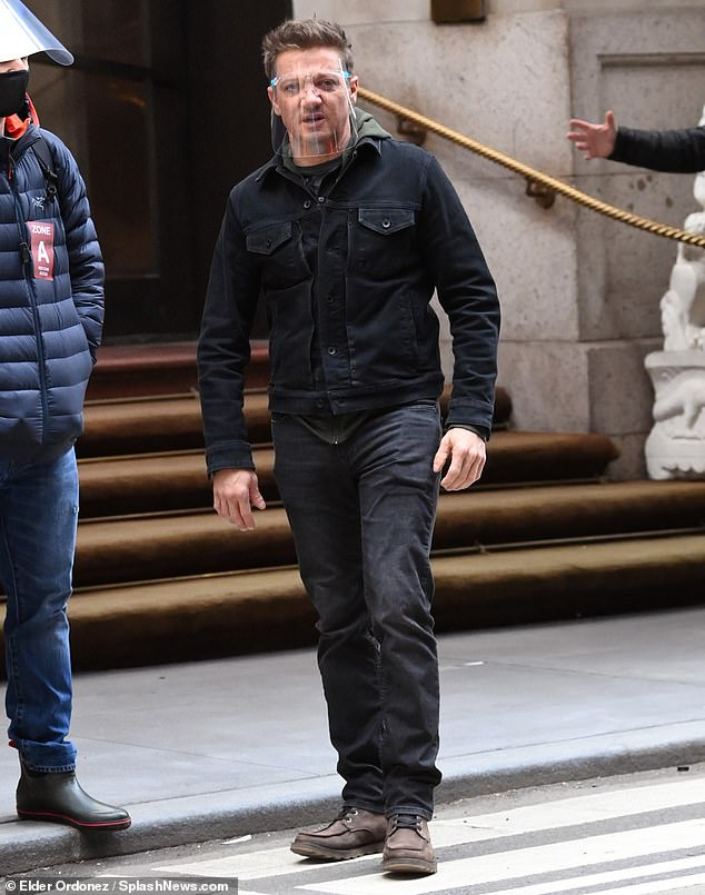 Cautious: Jeremy Renner and Hailee Steinfeld appeared to be putting safety first as they filmed scenes of the Hawkeye spin-off on Thursday, amid the ongoing COVID-19 pandemic