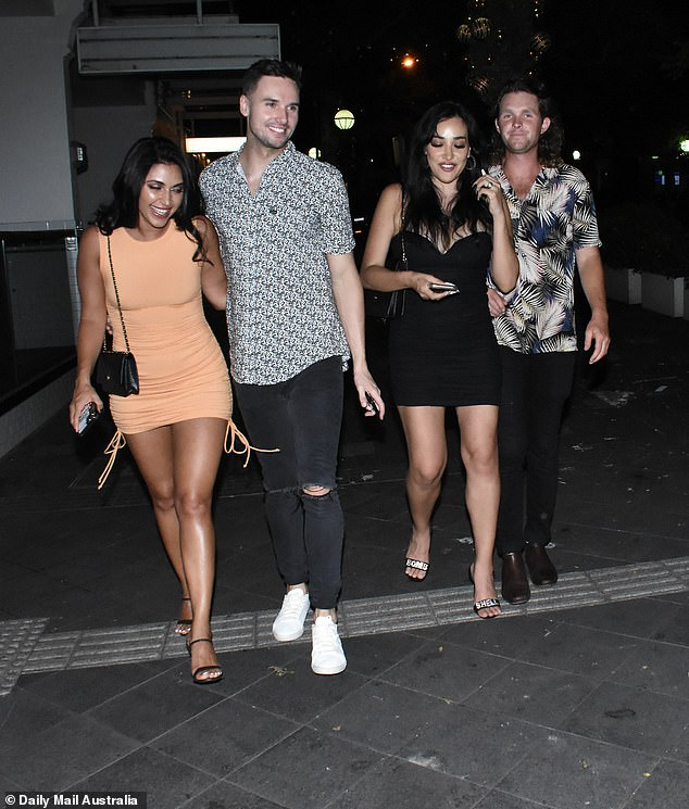 Worse for wear: The gang appeared to have quite the evening as they exited the club in Double Bay