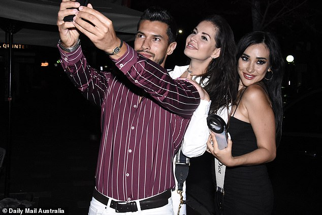 Smile!Rudy El Kholti appeared in high spirits as he took a cheeky selfie with the ladies