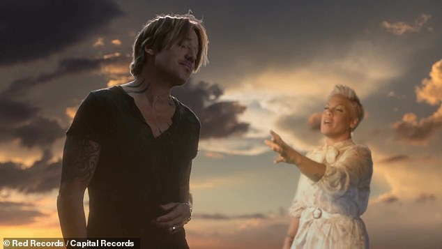 Pleased:Keith described working with Pink on their duet as a 'dream come true' for him as he knew it was perfect for her from the moment he wrote it in 2019. Pictured is the video for Omne Too Many