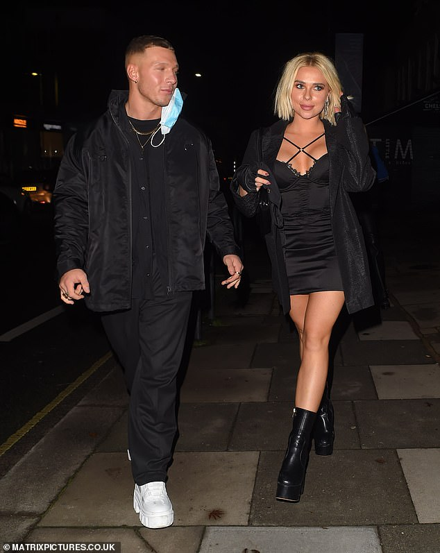 Loved-up:The personal trainer looked as smitten as ever with her boyfriend Brandon as the duo packed on the PDA while heading home