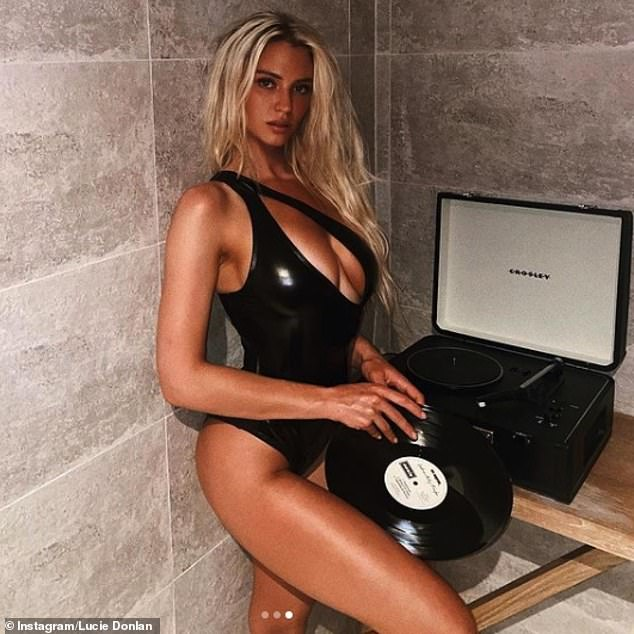 Leather look: The former Love Island star, 22, gave a sultry look at the camera in a deeply plunging leather-look swimsuit