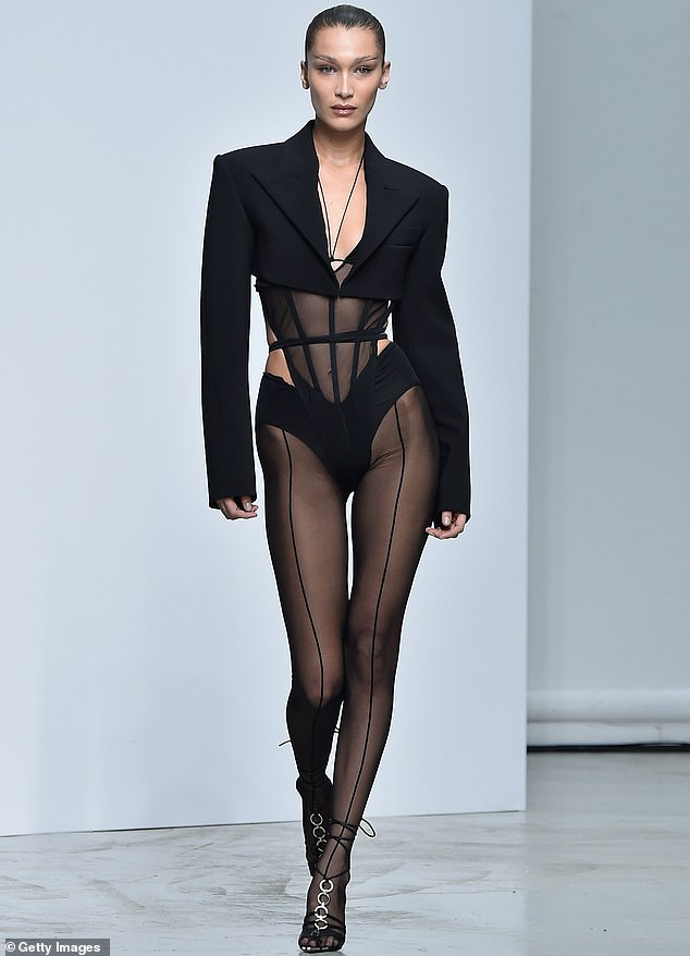 Walking the walk:The 24-year-old Instagram shared a few snaps of her trying on the outfit she wore on the Mugler show runway at Paris Fashion Week in September 2019 (pictured)