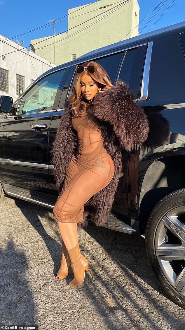 Cruise: Later, she leaned against a black Escalade with a pair of sunglasses perched on her beautiful brown hair and showed off in front of her tan open-toed stiletto heel boots