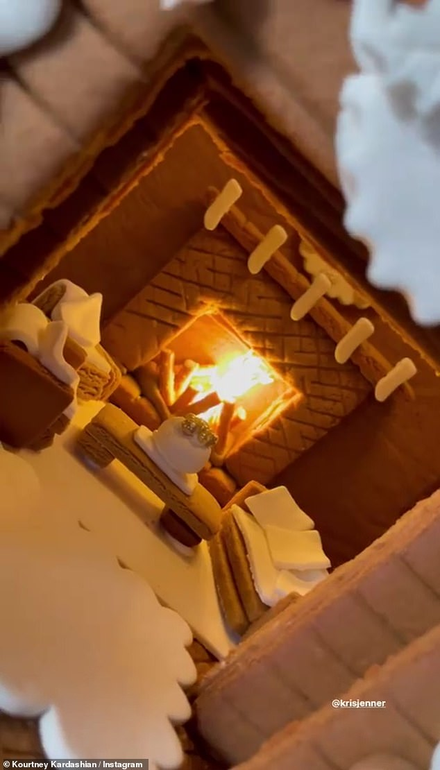 All the details:Kardashian captured every impressive detail of the two-story gingerbread house, which included a gingerbread man for each family member, a furnished living room, a roaring fireplace, and slew of other icing decor