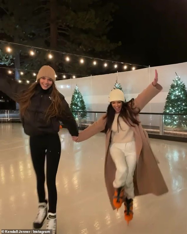 Living the life:While the beauties have shared multiple snaps of themselves frolicking in the snow and ice skating during their two-day trip, their cabin was brimming with amenities; Kendall and Kourtney pictured on Wednesday