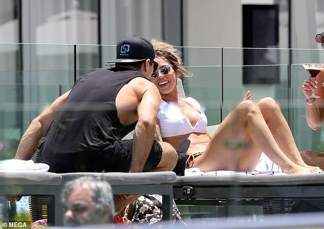 Reunited at last! Married At First Sight's KC Osborne, 31, (right) was spotted getting cosy with ex-'husband' Drew Brauer, 31, (left) as they relaxed by the pool in Cairns on Friday