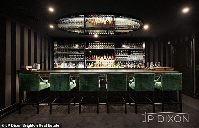 Fancy: The home includes a well-stocked bar area with plush seats and a high-end nightclub feel