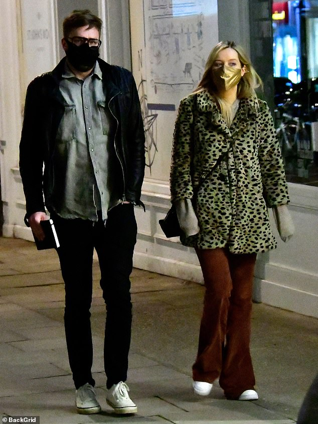 Date night: Laura Whitmore joined her fiancé Iain Stirling for a post-lockdown meal out in London on Saturday night following the easing of Covid-19 restrictions