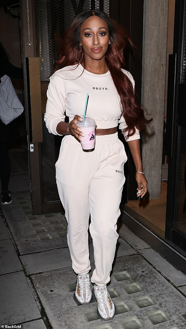 Keeping in shape: Alexandra Burke appeared to be in good spirits on Sunday as she stepped out of Anthony Joshua's gym BXR following a workout session