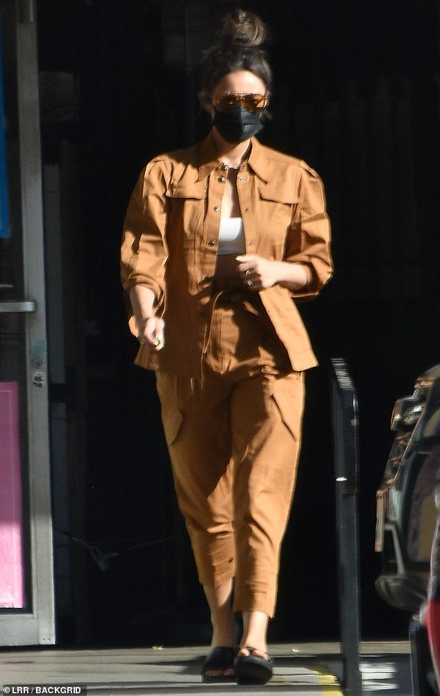 Casual chic: Shay Mitchell teased her taut tummy Sunday in a casual chic caramel ensemble, as she picked up her clothes from a laundromat in the Los Feliz neighborhood of Los Angeles