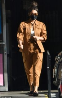 Shay Mitchell teases her taut tummy in chic caramel ensemble as she picks up her laundry in LA