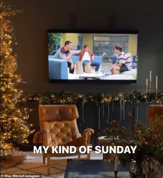 Holiday spirit: She also shared a glimpse of her beautiful Christmas tree, as she sat on the couch and panned up, writing: 'My kind of Sunday'
