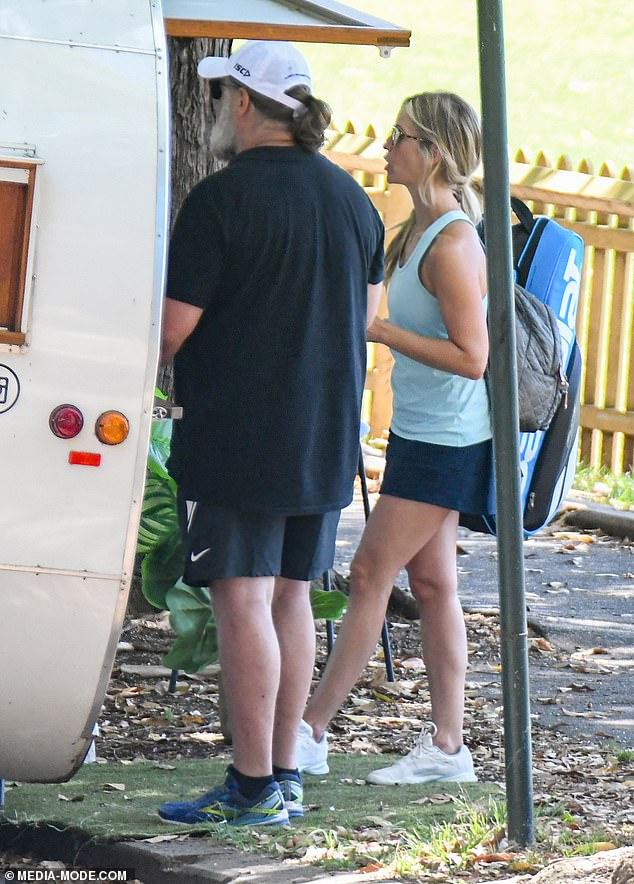Unwinding: After their friendly tennis game came to an end, the pair made their way to a nearby cart where Russell picked up a coffee