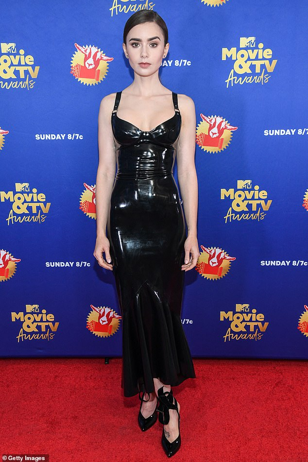 Back in black: Lily Collins, 31, made an eye-catching appearance Sunday at the MTV Movie & TV Awards for its Greatest of All Time edition in a stunning black latex dress
