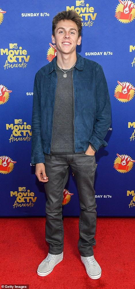 Just kickin' it: Stars of Netflix's Kobra Kai, Xolo Mariduena and Jacob Bertrand left their mark on the evening's red carpet before heading inside