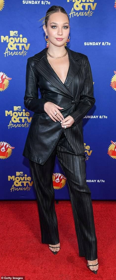 Inspired: Maddie Ziegler took some style inspiration from supermodel Bella Hadid in a black leather trench coat and a pair of crimped trousers