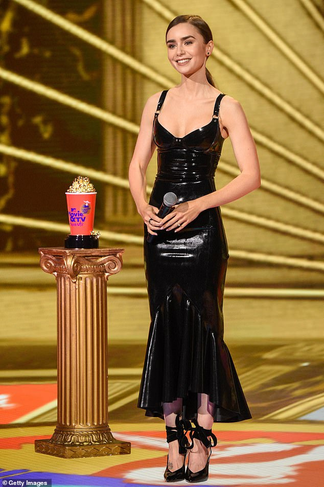 Classic: Lily presented the golden popcorn for the most heartbreaking breakup of all time, which went to Jason Segel's nude breakup with Kristen Bell in Forgetting Sarah Marshall
