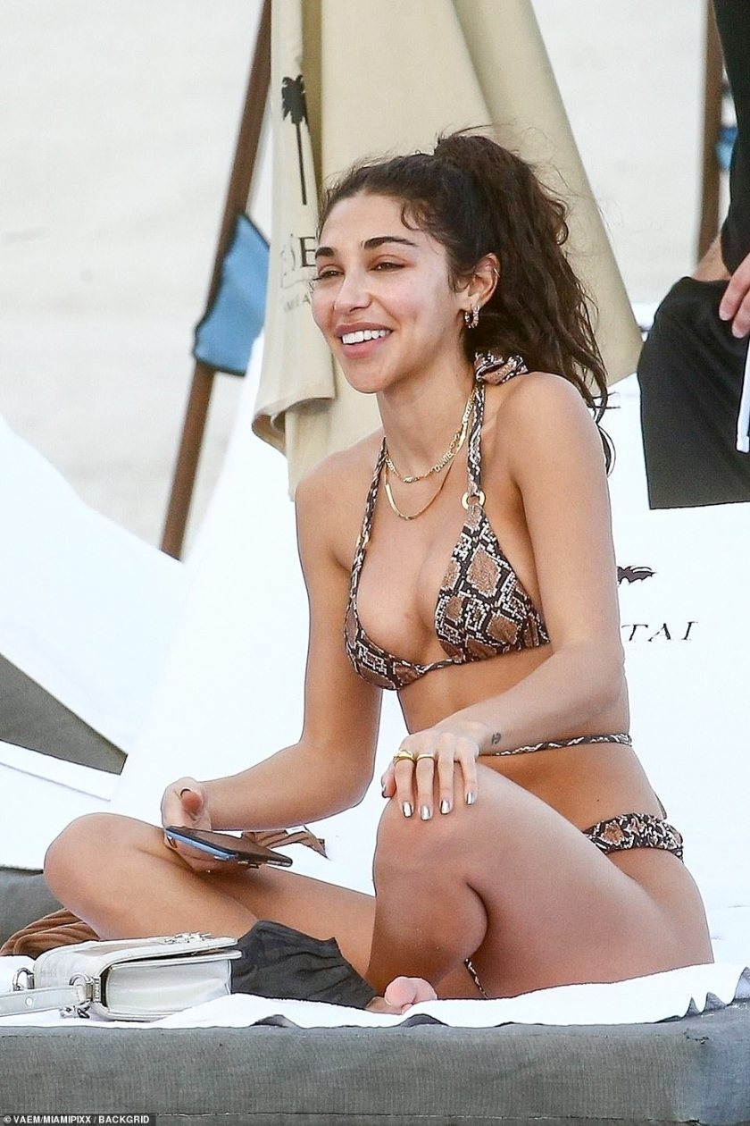 Snakeskin:For her relaxing beach day, the DJ-turned-model, 28, slipped her famously fit physique into a slinky snakeskin two piece