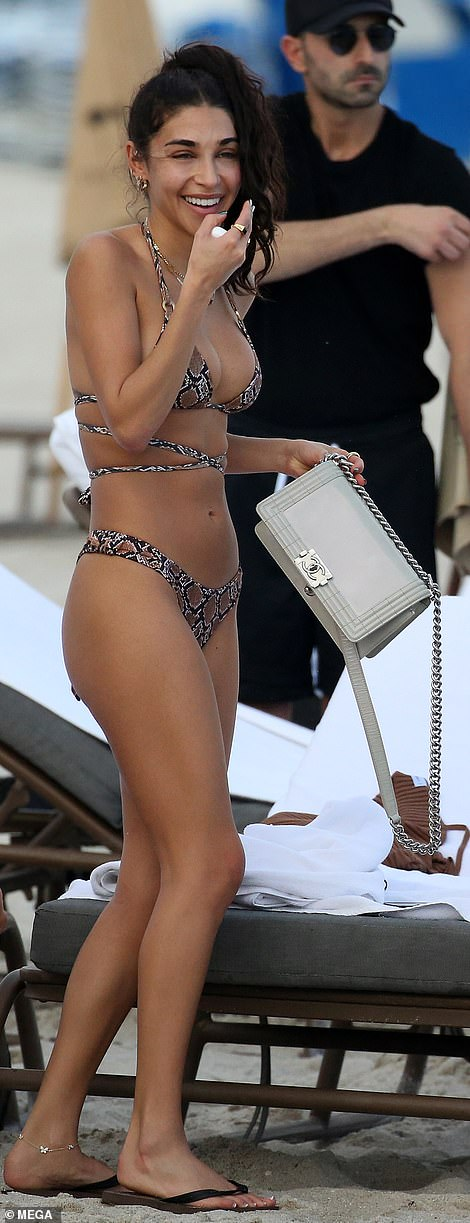 Wow factor: No doubt all eyes were on her in the patterned thong bikini