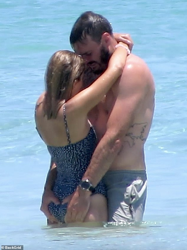 Wet and wild! The Bachelor's Locky Gilbert couldn't keep his hands off his girlfriend, Irena Srbinovska, on Monday as they enjoyed a swim at Leighton Beach in Perth