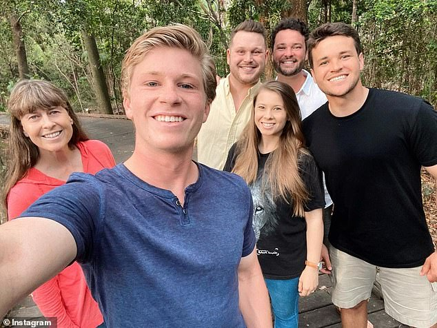 'Good times': Robert Irwin, 17, looked all grown up as he shared a sweet group photo to Instagram on Wednesday. Pictured from left: Terri, Bindi, Chandler, and Australia Zoo employees