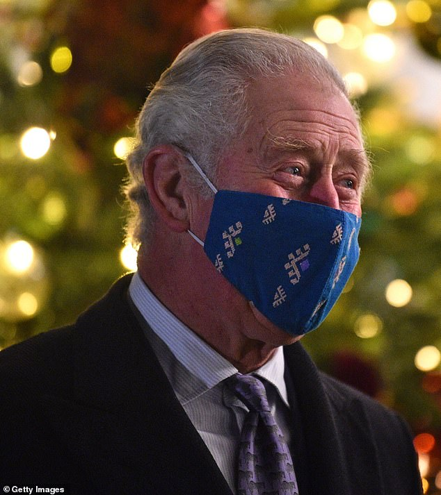 Charitable Charles:Prince Charles last night re-wore one of his favourite face masks - a £6.50 teal design crafted by seamstresses from his Turquoise Mountain Textiles programme