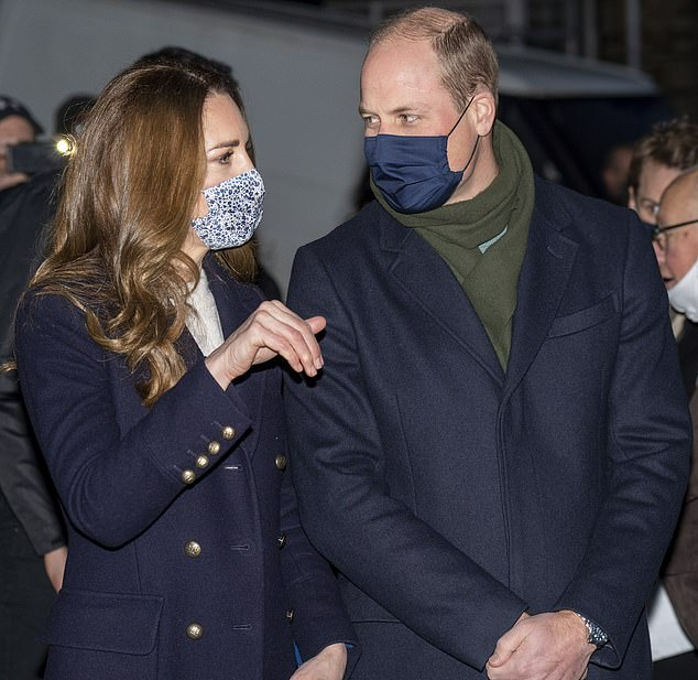 Royal blue: Prince William wore a plain navy mask during the visit to West Yorkshire this week