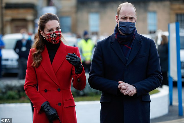 Classic: Kate also wore a £15 tartan mask from Emilia Wickstead - another go-to designer