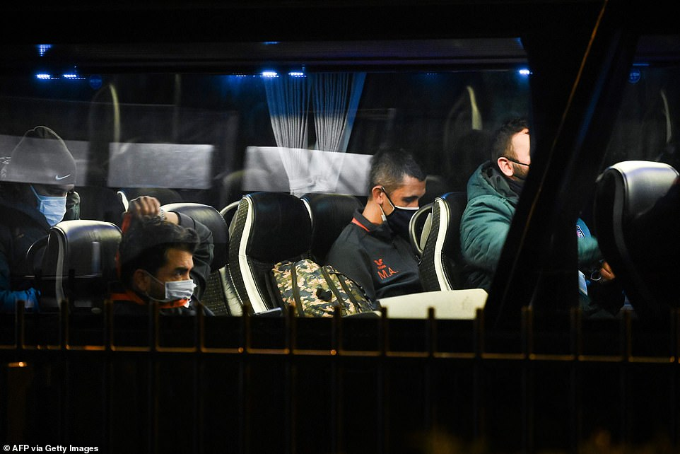 Basaksehir players sit on the team bus as they prepare to make their way back to the hotel