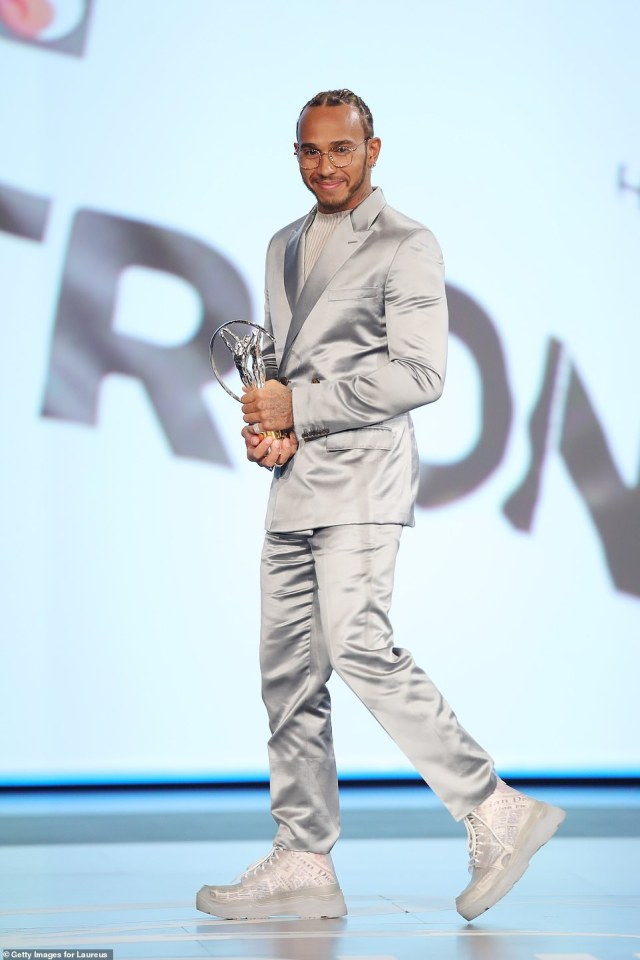 Even a traditional suit is given a twist at Hamilton's hands, with the racing ace choosing a metallic silver style for the2020 Laureus World Sports Awards. The fashion maverick eschewed a traditional suit in favour of a knitted top and added trainers by Dior