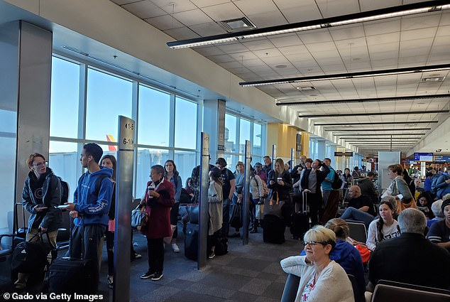 Airports were packed around the world in December, January and February, despite confirmation that the virus was spreading. Pictured: Oakland International Airport on January 5