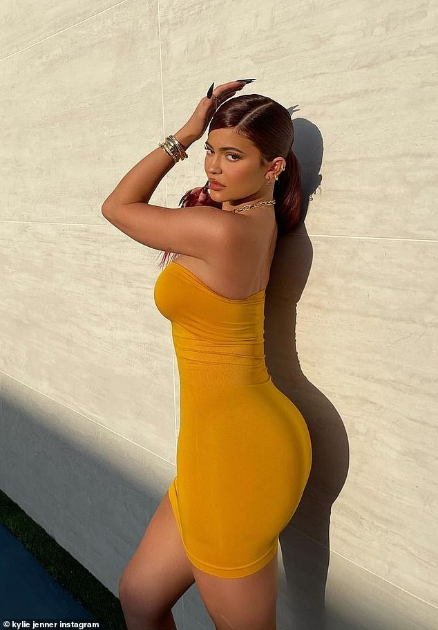 Booty: As she faced the strong sunlight in her snap, Jenner posed with both hands on her incredibly toned midriff and smoldered intently at the camera