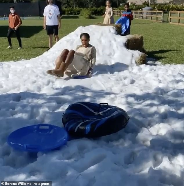 Serena Williams has a blast sledding on fake snow in Florida as daughter Alexis gives her a push