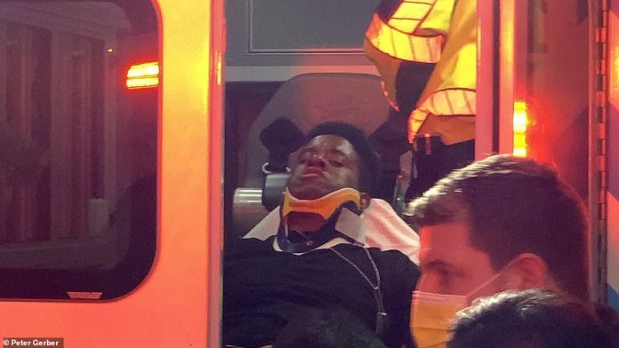An injured protester is seen loaded into an ambulance after the incident