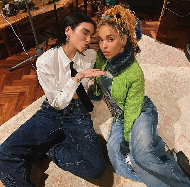 Cycle: Twigs, pictured with singer Dua Lipa, said she filed the lawsuit and was speaking out to show how someone with a large network like herself could be caught up in an abusive cycle