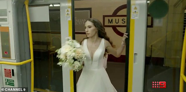In a hurry:Two other brides appear in the clip, one who is rushing for a train in her wedding dress, understood to be Belinda Vickers (pictured) from Melbourne