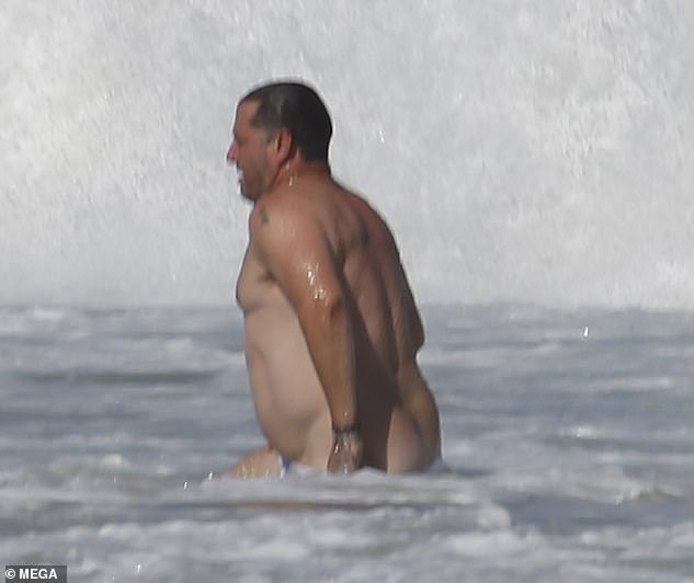 Cheeky: On Saturday, Karl Stefanovic (pictured), 46, gave beachgoers more than they bargained for, when his boardshorts slipped down in the surf at Queensland's Noosa Beach