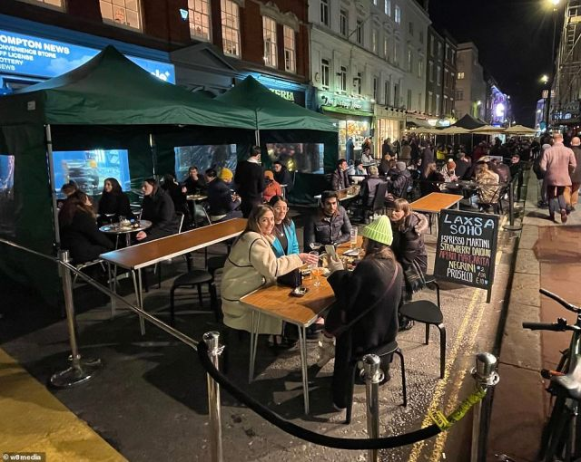 High streets were packed with eager Christmas shoppers yesterday as Covid-weary spenders give Britain's hard-hit businesses a £1.7billion boost. Pictured: Diners in Soho