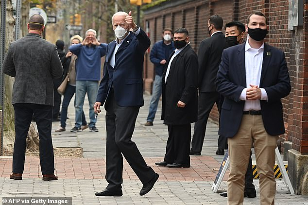 Joe Biden gave a thumbs-up as he walked out of a Philadelphia hospital after a follow-up exam on his foot which he fractured while playing with his pet dog Major