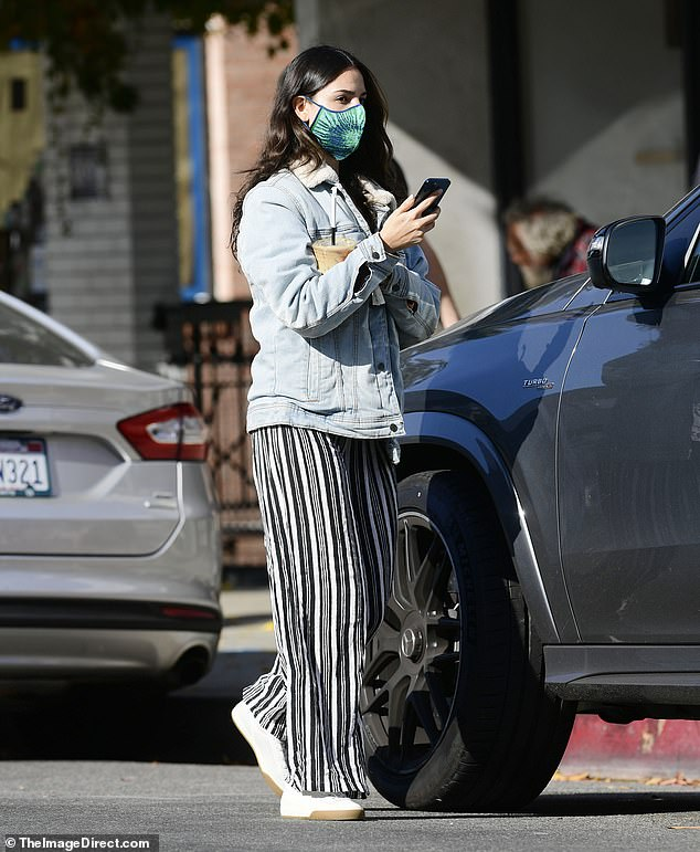 Cozy:For her midday caffeine fix, the Mexico City native donned a cozy fleece-lined denim jacket