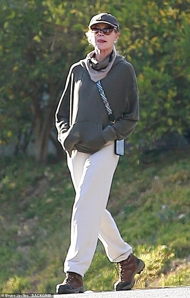 Sporty: The Working Girl star wore white sweatpants with a hoodie and baseball cap